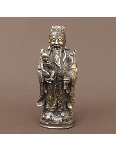 Figura de bronce. Sabio con niño y pergamino